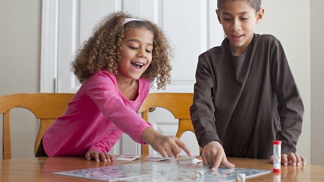 Children playing boardgame