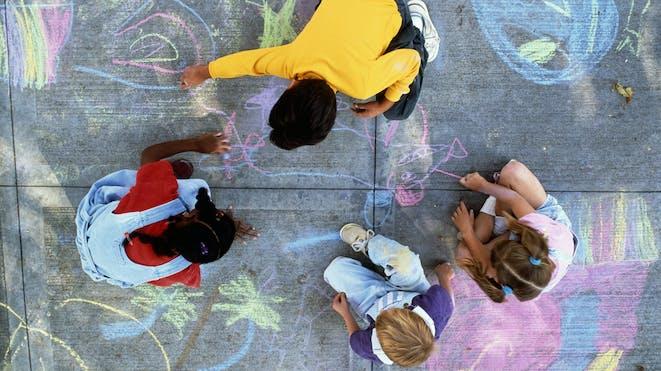 Children playing with sidewalk chalk