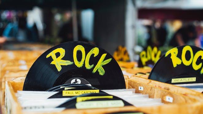 "Vinyls labelled ""Rock"" in crates"