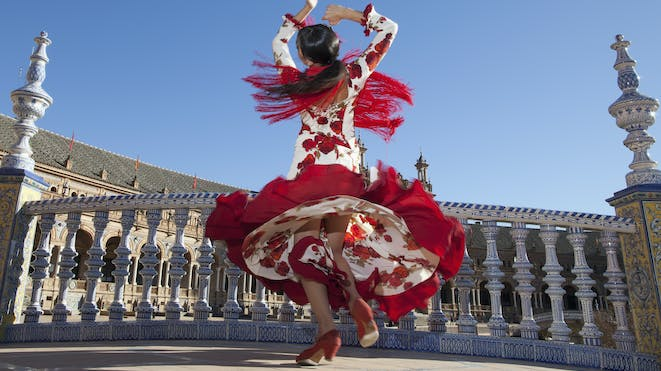 Spanish woman dancing in red and white dress