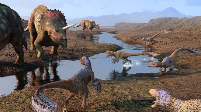 Dinosaurs on a river bank