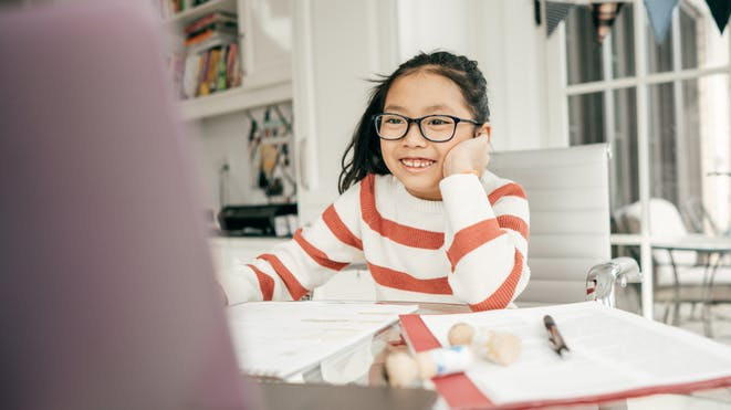 Girl with glasses on computer
