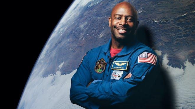 Astronaut leland melvin with earth