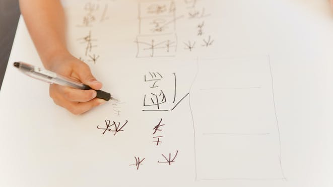 Student writing mandarin characters