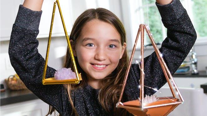 Girl holding rock formation displays